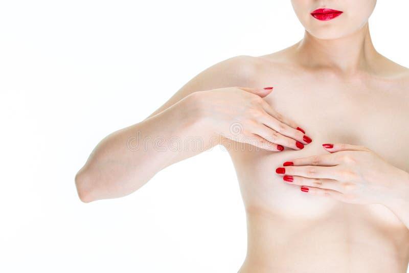 Examen del uno mismo contra el cáncer de pecho, pecho femenino joven del examen para el si imagen de archivo