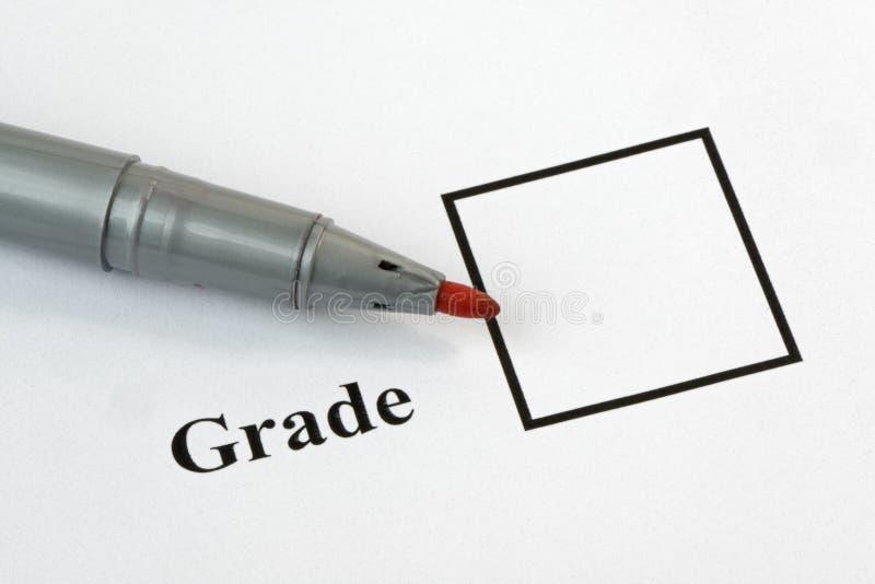 Examen graderar arkivbild