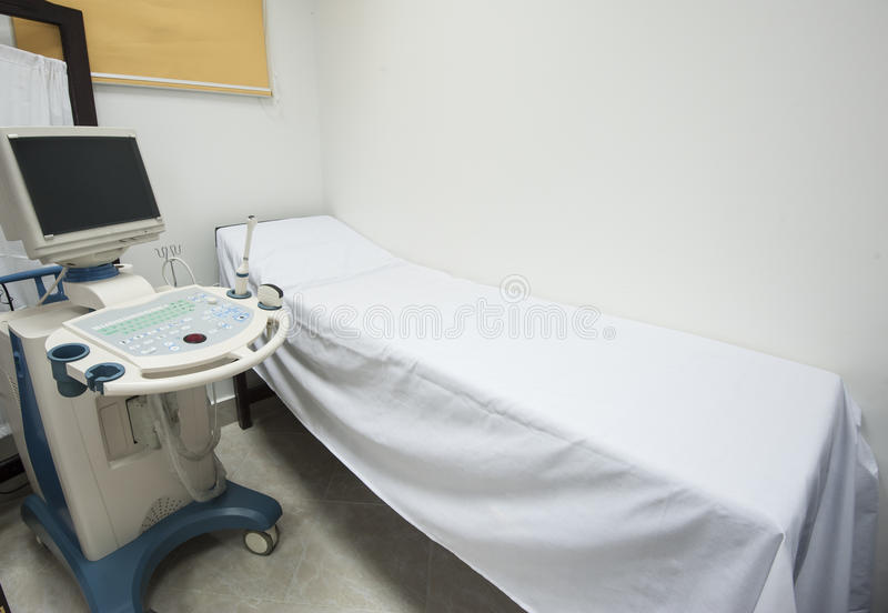 Examination bed and ultrasound scanner. Examination bed with ultrasound scanner machine in medical center hospital royalty free stock image