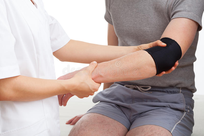 Examination of elbow stock photos
