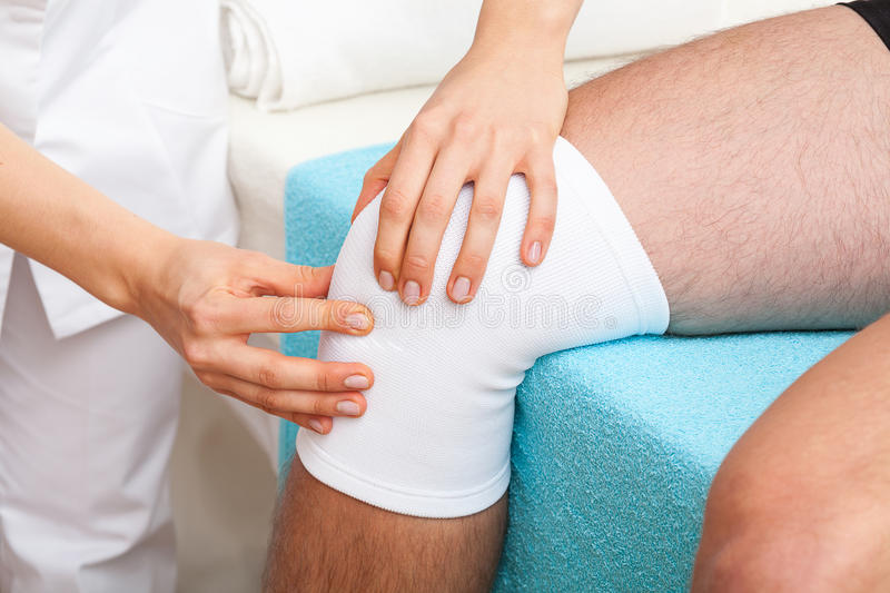 Examination of knee stock image