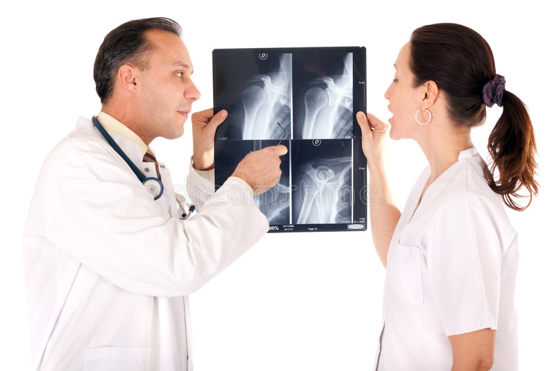 Examining x-ray. Medical team looking x-ray isolated on white background royalty free stock photography