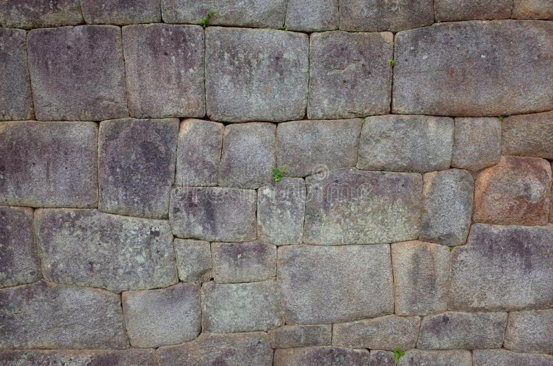 Example of Inca brickwork inside Machu Picchu. The straight nature of the bricks suggest this building was important, perhaps religious or the living quarters stock photography