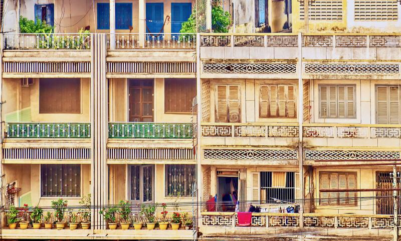 An example of older Cambodian urban architecture, which is being quickly replaced by modern construction. Two neighboring Cambodian apartment building facades royalty free stock photos