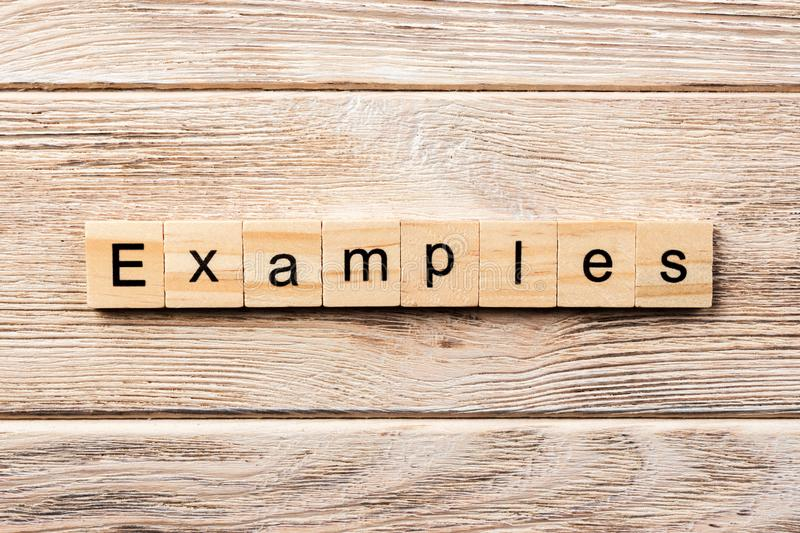 Examples word written on wood block. examples text on table, concept.  royalty free stock images