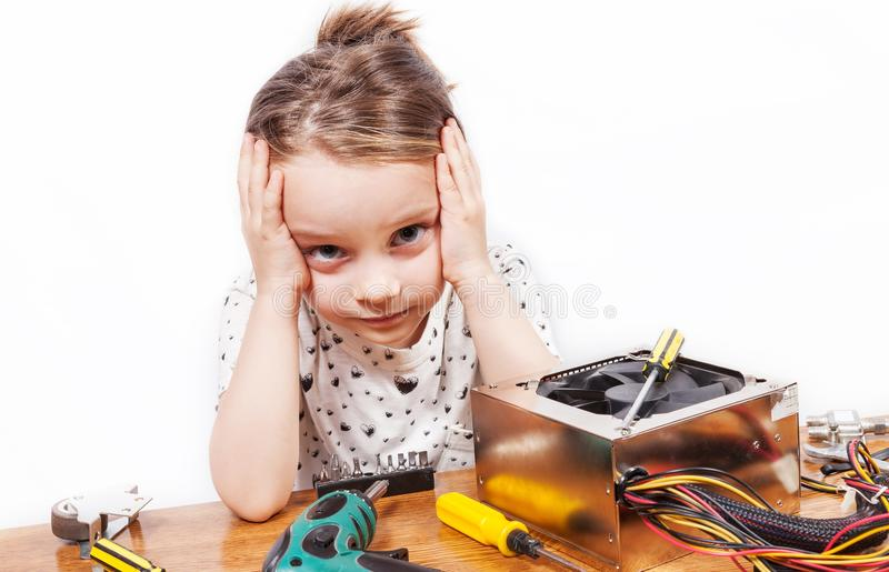 Exasperated girl while repairing PC components. Exasperated girl while repairing components of a PC stock photos