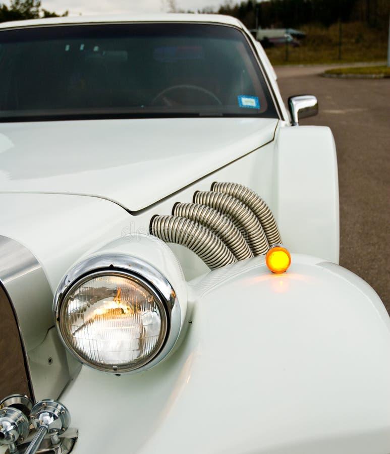 excalibur车灯大型高级轿车 图库摄影