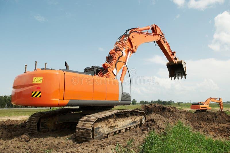 Excavador del cargador en la construcción fotografía de archivo