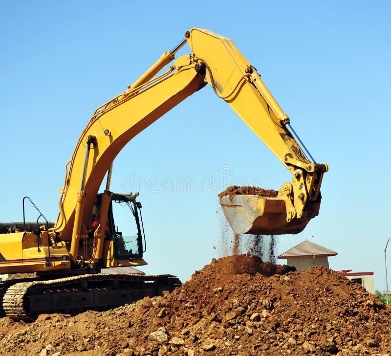 Excavador y suciedad foto de archivo