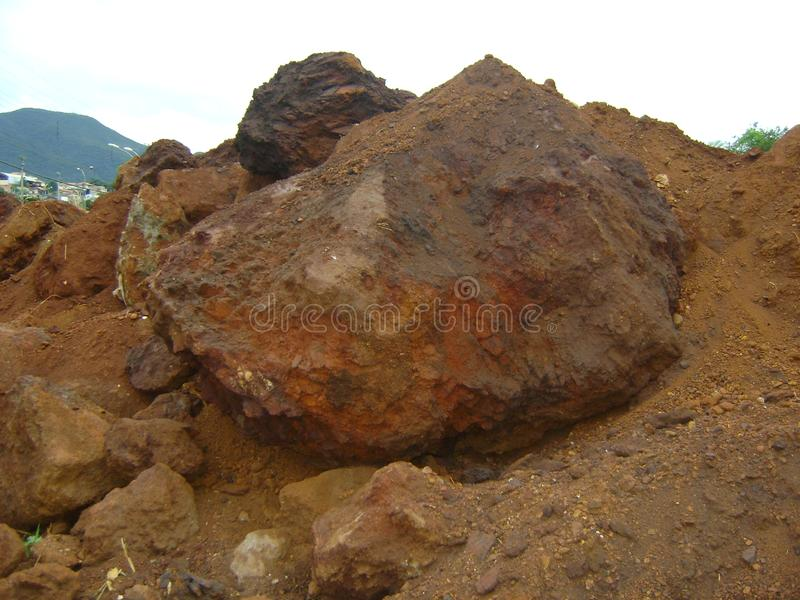 'Iron ore on the rocks. Heap of iron ore land, on land being excavated for construction in Barrão de Cocais, Minas Gerais. The area is all of ore stock photo