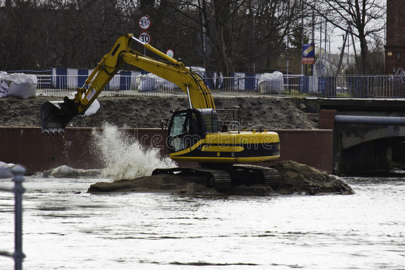 Excavator. Deepening the river stock photos