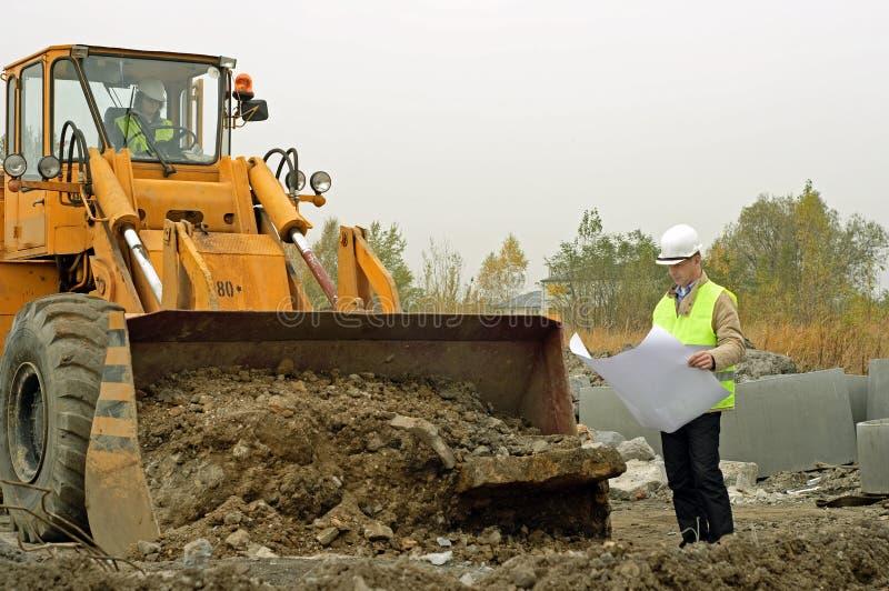 Excavator and architect. stock photography