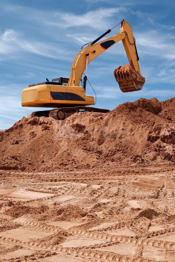Excavator bulldozer in sandpit royalty free stock photography