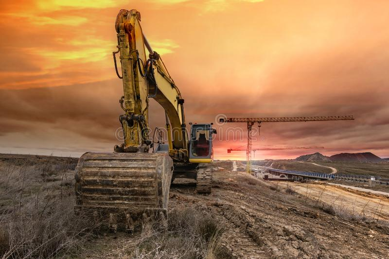 Excavator on the construction works of a highway and a bridge royalty free stock images
