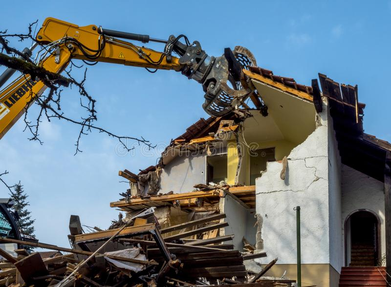 Excavator demolishing a house. Bavaria, Germany, Europe stock photos