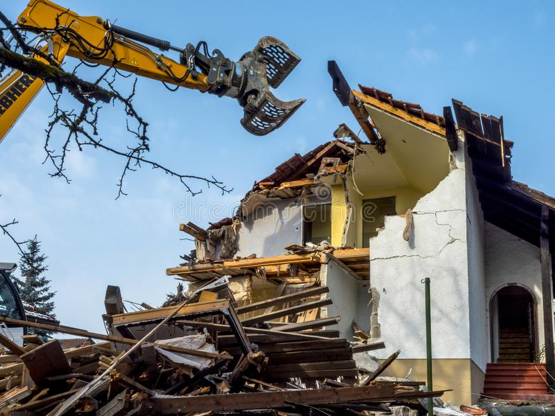 Excavator demolishing a house. Bavaria, Germany, Europe stock images