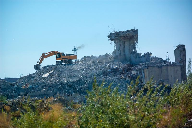 Excavator demolishing an old building, the demolition of the building.  royalty free stock photo