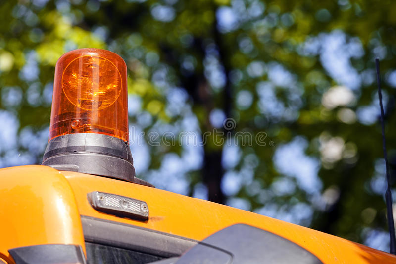 Excavator digging rotating light. View on rotating light of new excavator digging; note shallow depth of field royalty free stock photography