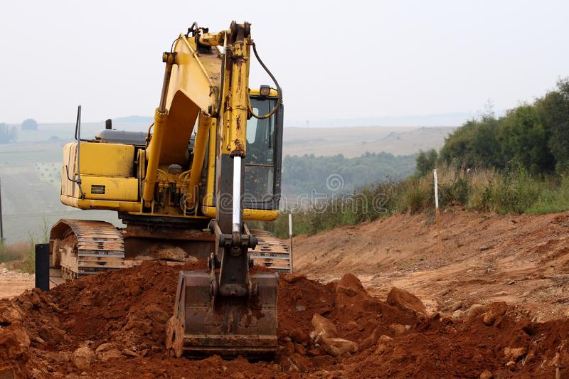 Download Excavator Digging Up Some Ground And Rocks #3 Stock Photo - Image of machinery, boom: 8578362
