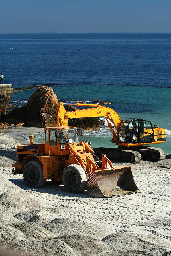Excavator / dredge at work. / Reconstruction of a beach stock photos