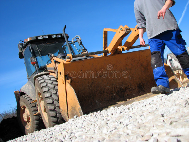 Excavator driver. And his tractor on the construction site stock image