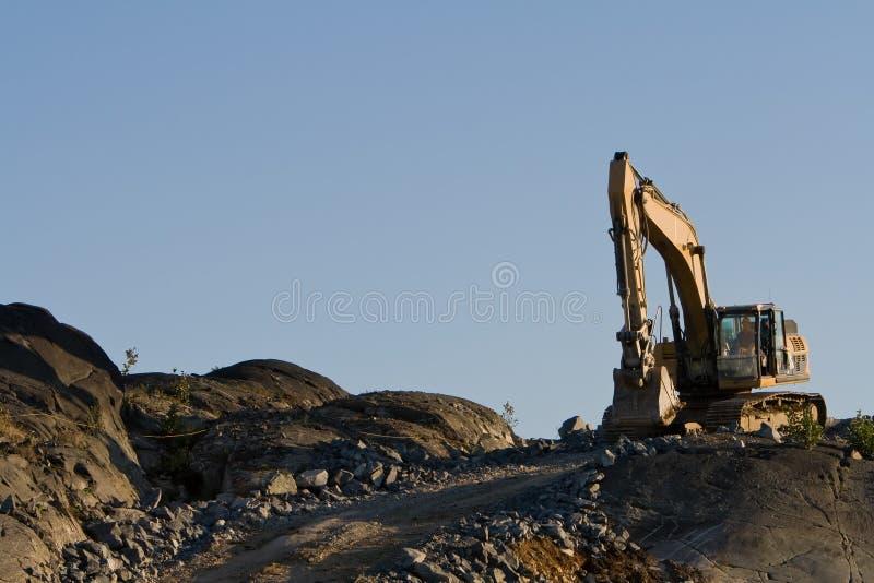 Excavator driving stock photo