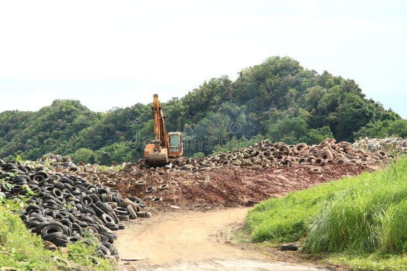 Excavator on dump stock photos