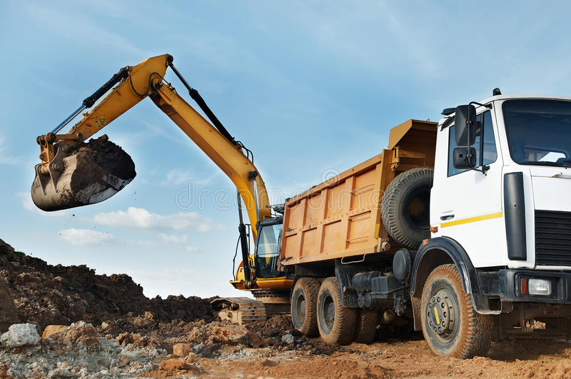 Excavator And Dumper At Loading Royalty Free Stock Photo