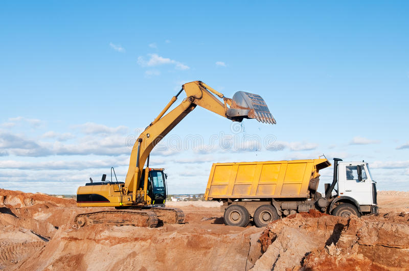 Excavator and dumper truck stock photography