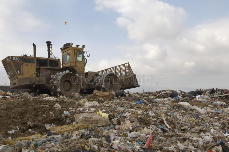 Excavator At Dumping Ground. Excavator loader working at dumping ground royalty free stock image
