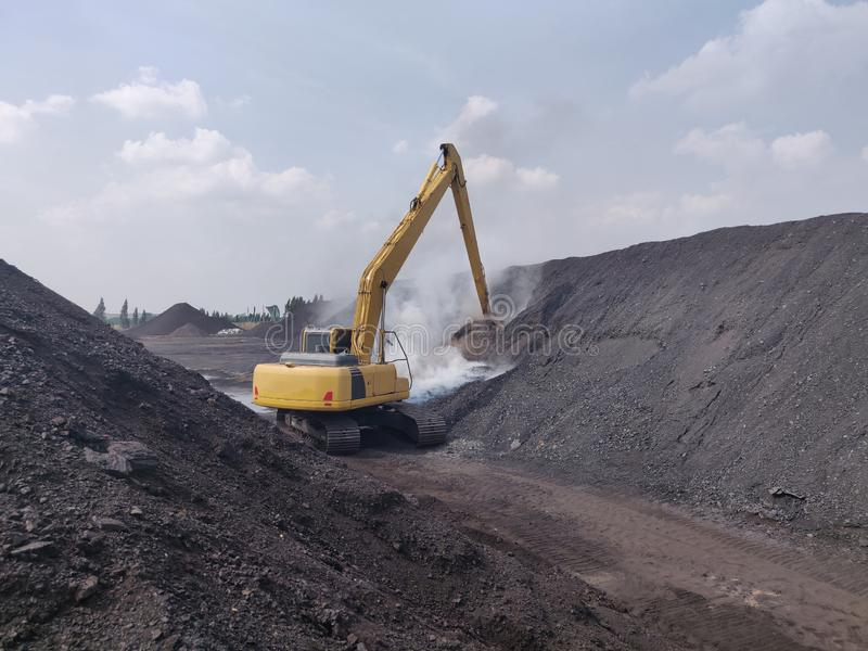 The excavator extinguish fires from coal spontaneous combustion royalty free stock photos
