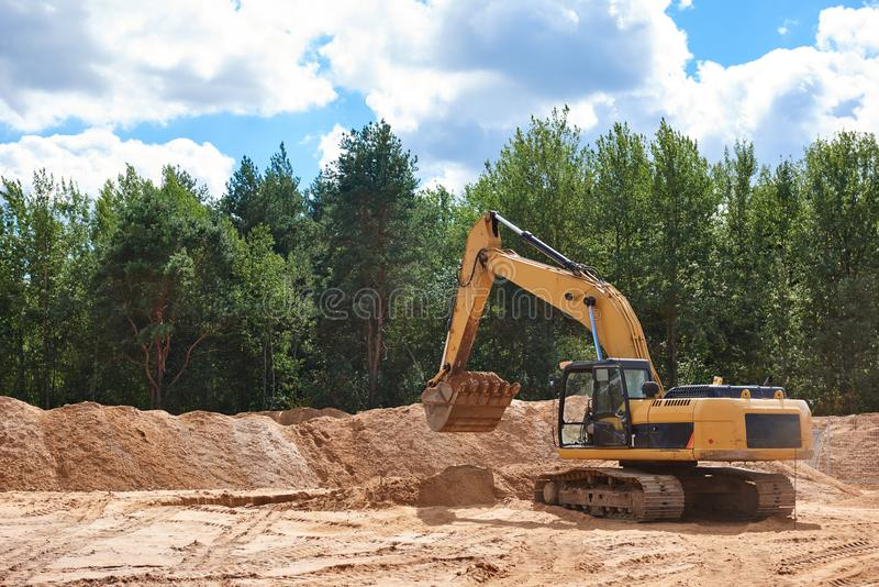 Excavator Loader at earth moving works royalty free stock images