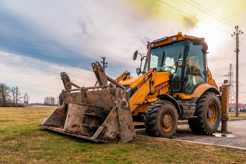 Excavator loader in a parking lot for road transport royalty free stock photo