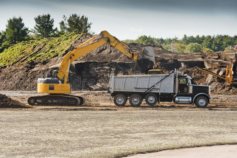 Excavator Loading Dumper Truck Royalty Free Stock Photography