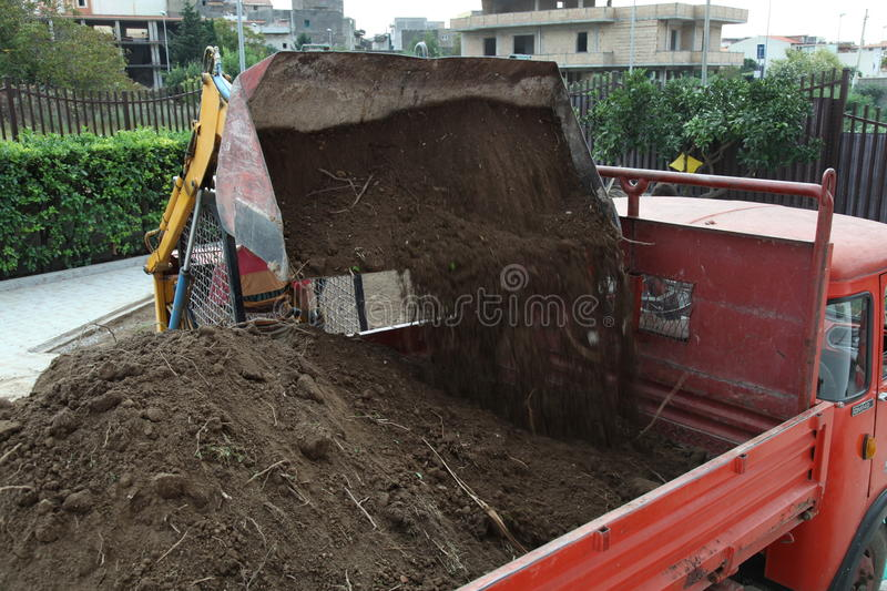 Excavator loading dumper truck tipper royalty free stock photography