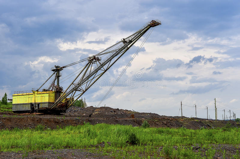 Excavator machine at excavation earthmoving work in quarry royalty free stock photography
