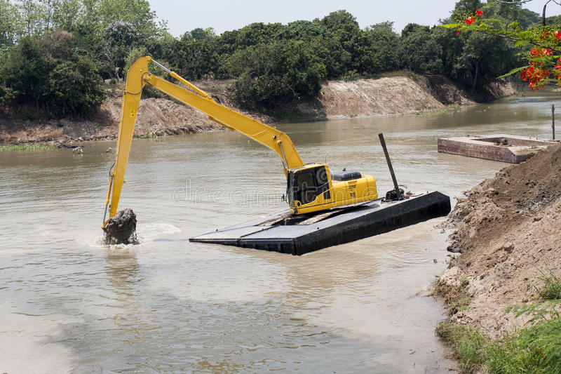 Excavator Machine  Works At River Royalty Free Stock Image