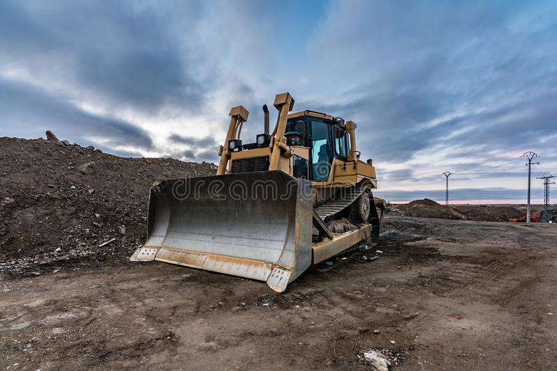 Excavator making earth movements for the construction of a road. In Spain stock images