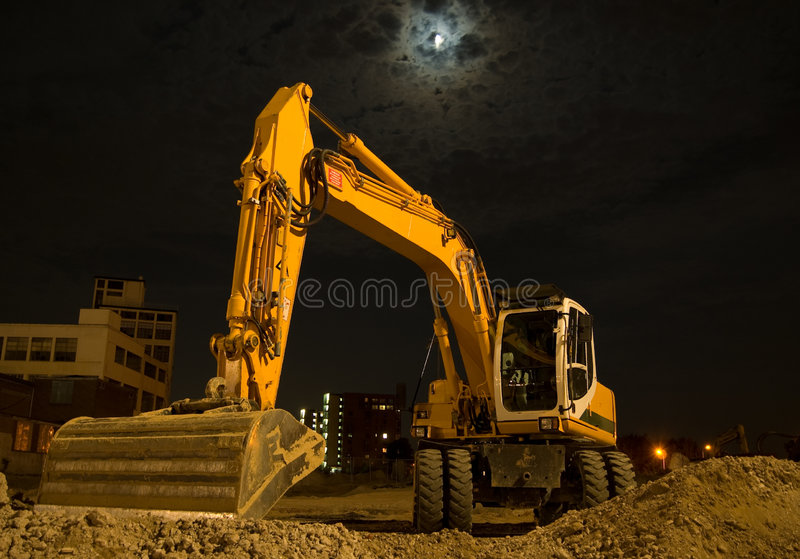 Excavator By Night Stock Photos