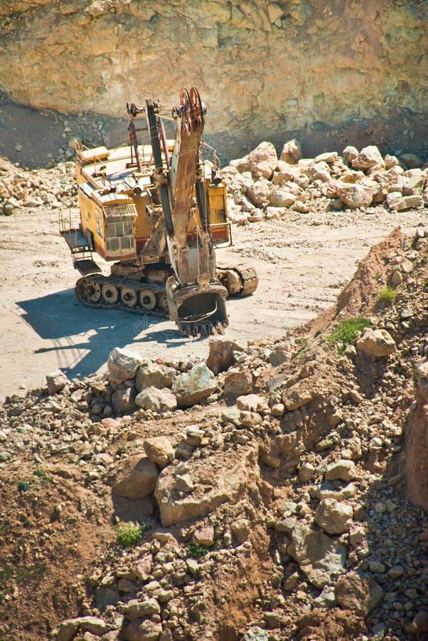 excavator in open cast stock photos