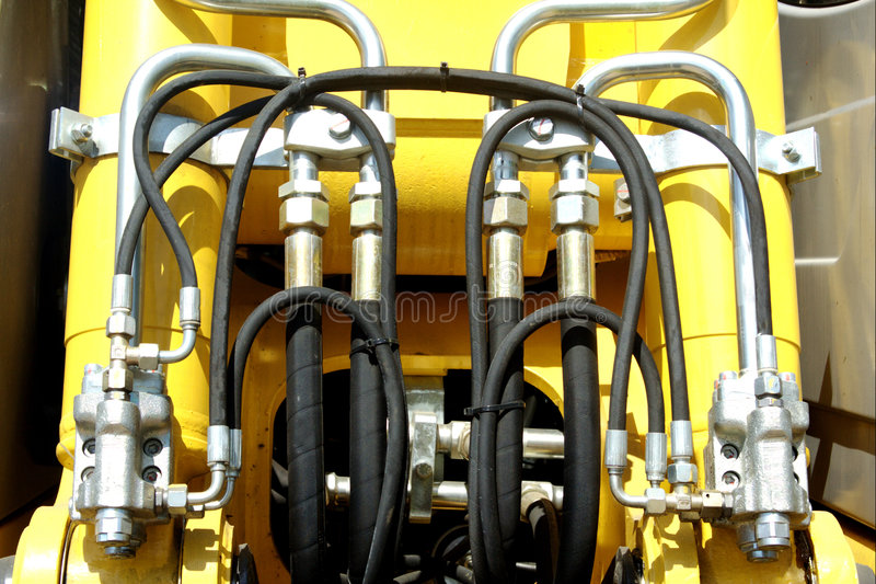 Excavator pressure pipes system stock images
