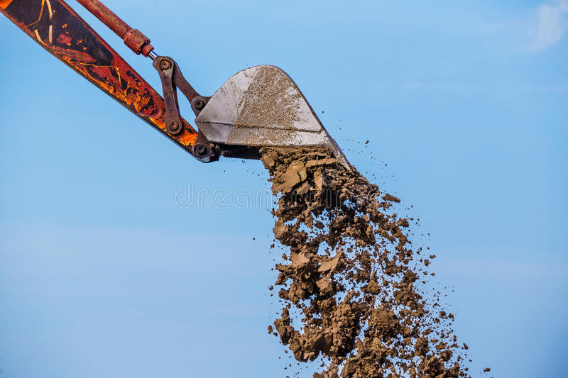 Excavator on the reclamation. Land royalty free stock image