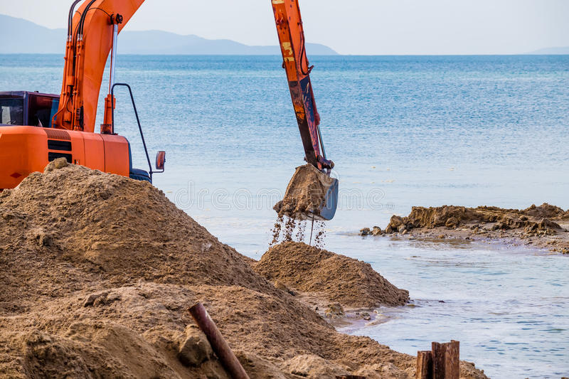 Excavator on the reclamation. Land royalty free stock images