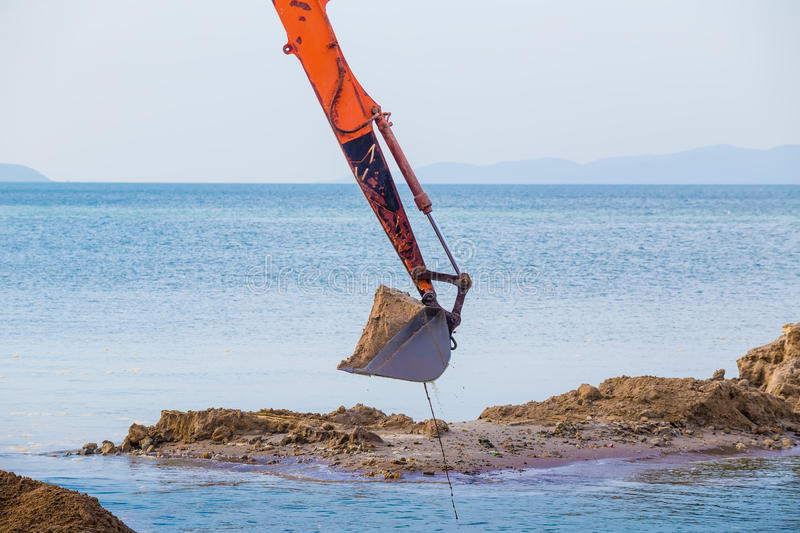 Excavator on the reclamation. Land royalty free stock photography