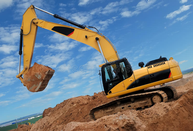 Excavator in sandpit royalty free stock photo