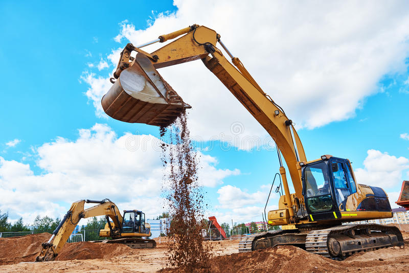 Excavator at sandpit during earthmoving works royalty free stock photography