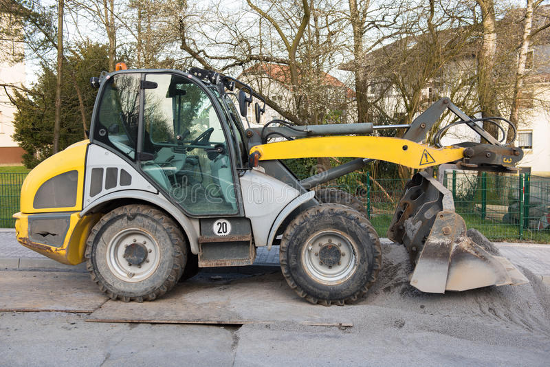 Excavator standing on steel platters, ready for work.  stock images
