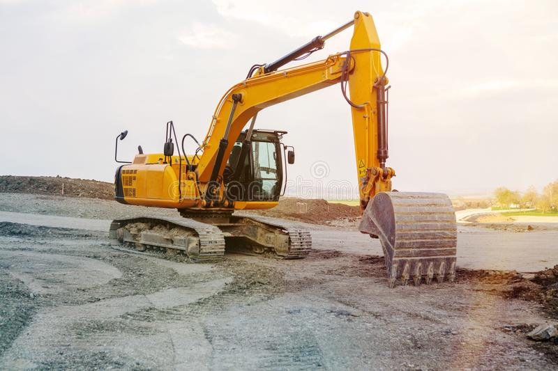 Excavator at street construction site on the countryside stock image
