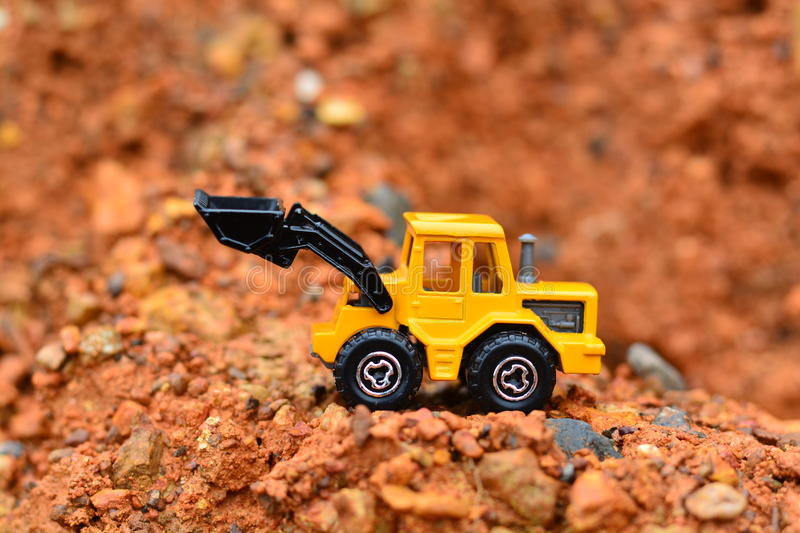 Excavator Toy work at construction site stock photo
