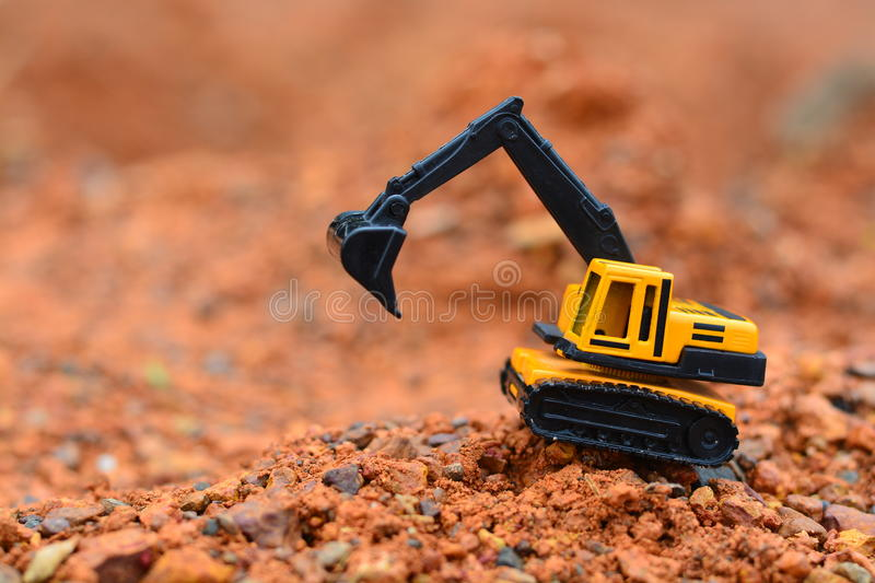 Excavator Toy work at construction site royalty free stock images